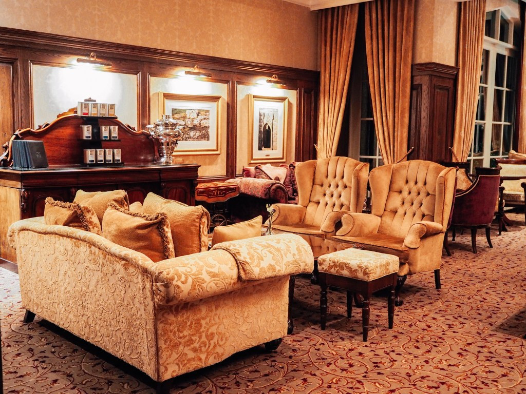 Cream textured couch and two armchairs in the lobby of Lough Erne resort in Northern Ireland