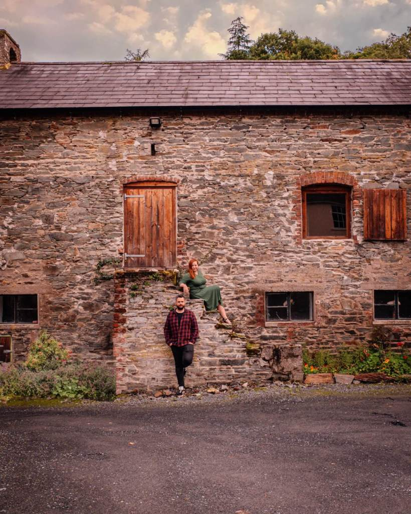 Couple posing at a barn in Dunmore House and Gardens in Carrigans Donegal perfect if you are looking for staycation ireland ideas.