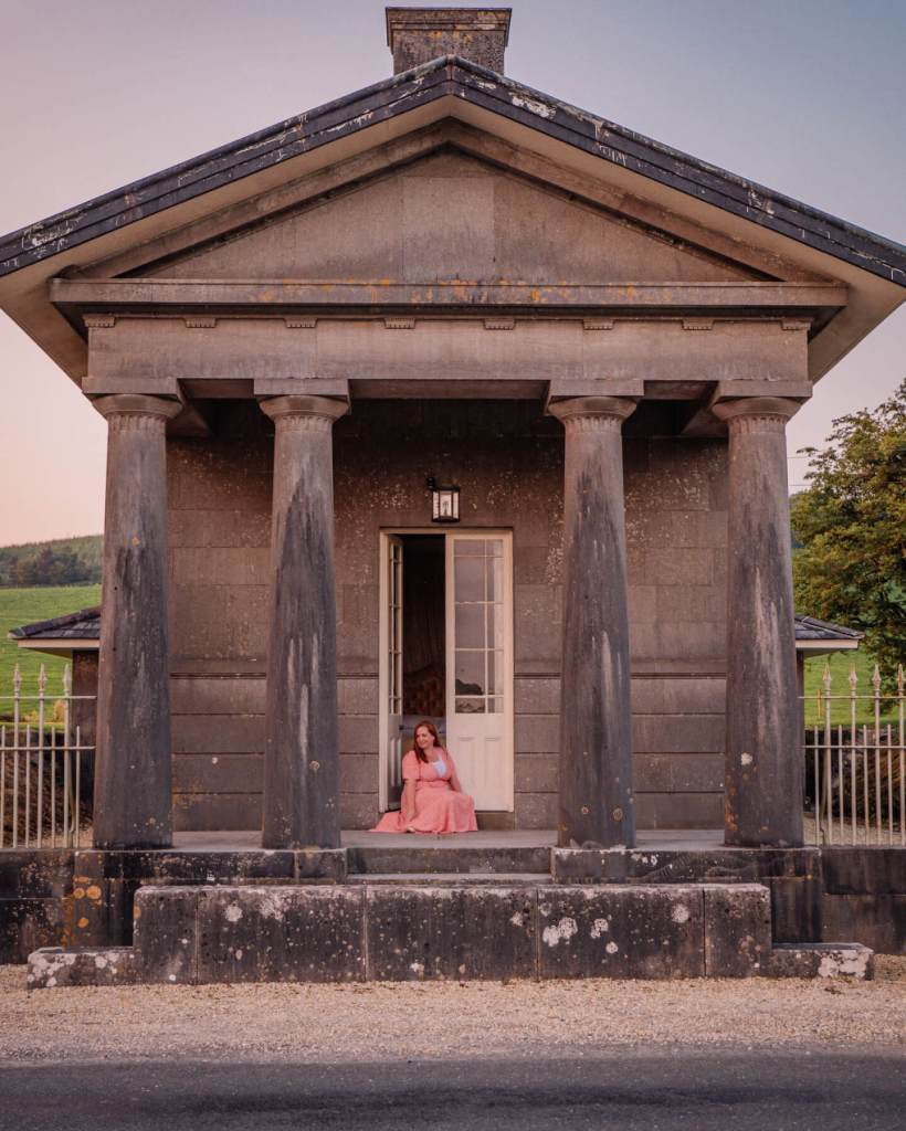 Woman sitting outside her bedroom at Loughcrew Lodge a unique place to stay in Ireland