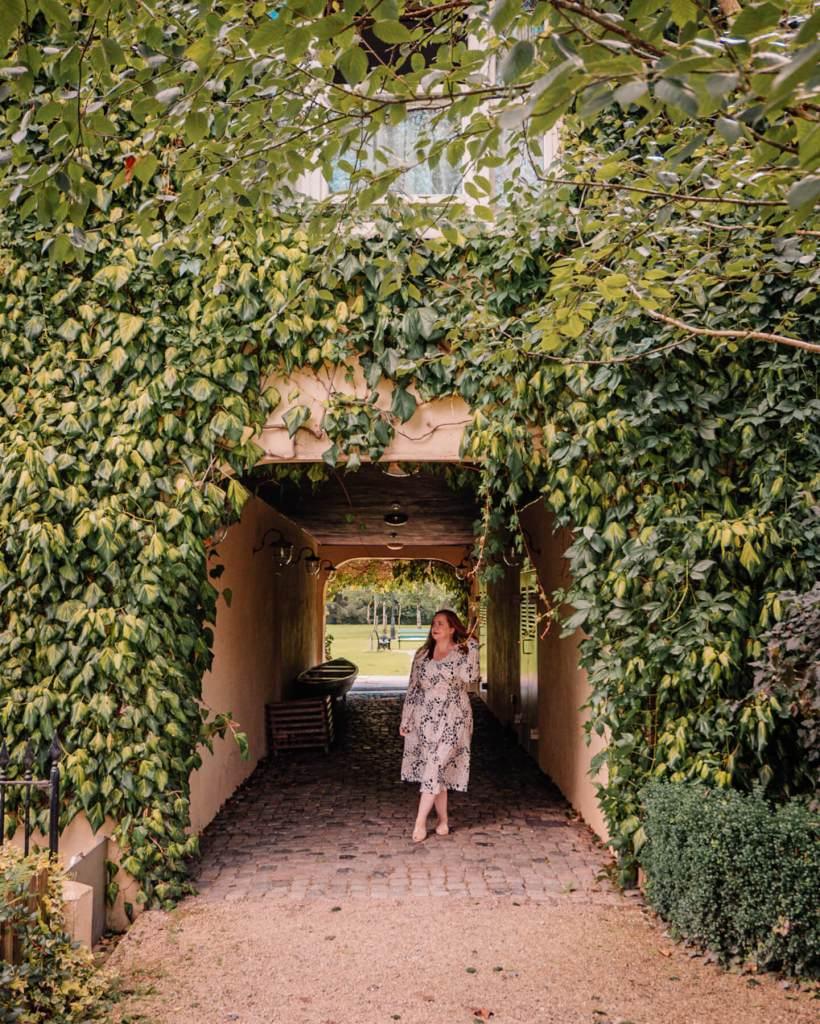 Woman standing in the doorway of Brooklodge and Macreddin Village in Wicklow Ireland