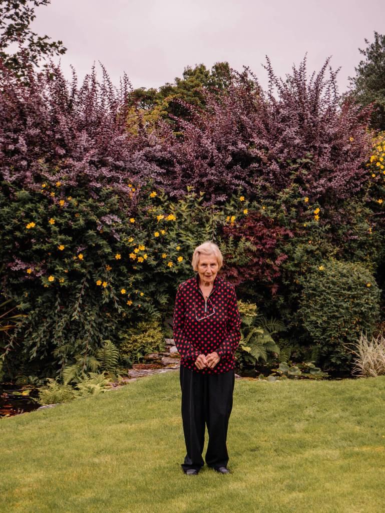 Elderly lady standing in Shekina Sculpture Garden in Wicklow Ireland