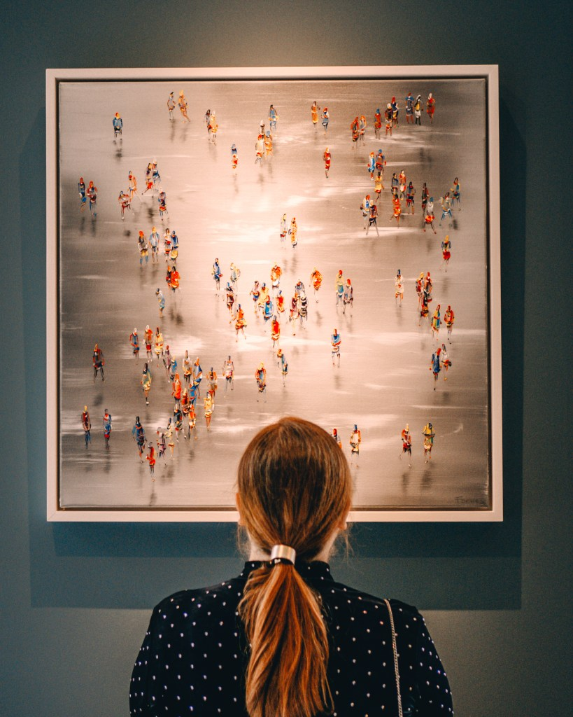 Woman looking at a Stephen Forbes painting at the Art & Soul exhibit in Culloden Estate