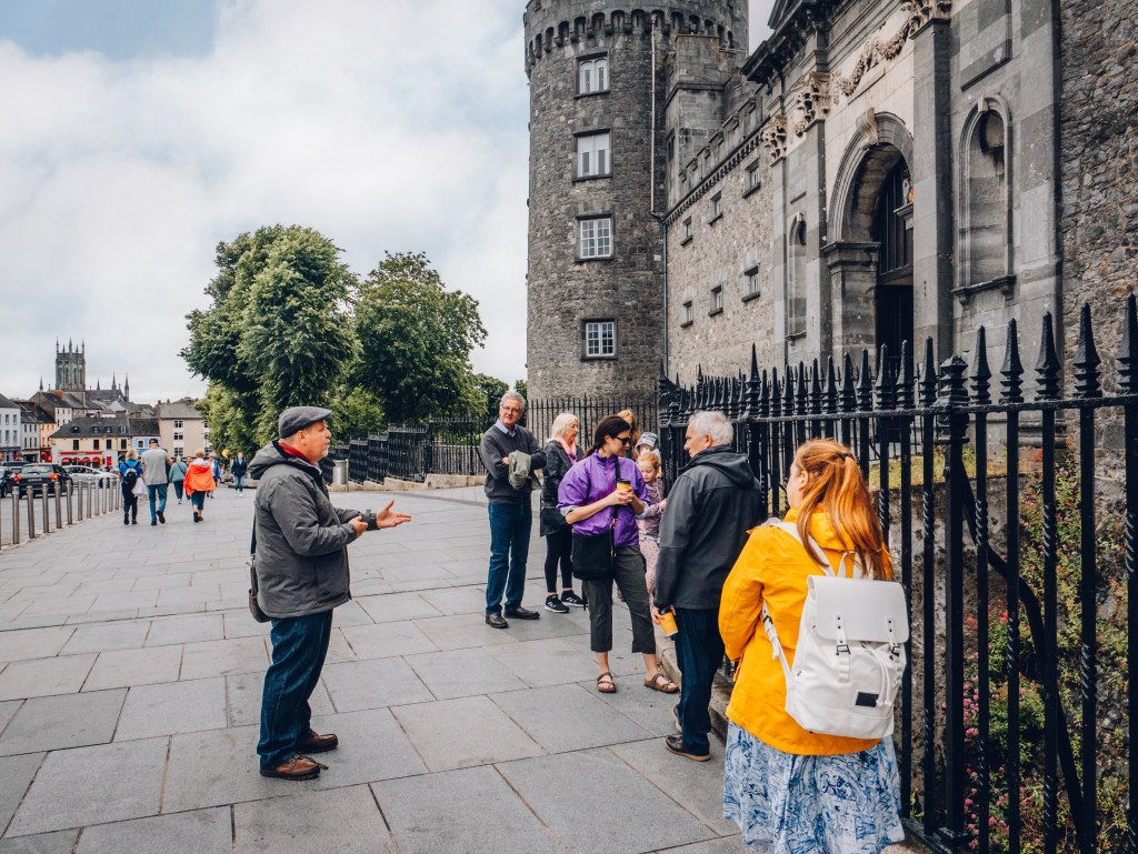 Group of travellers on a walking tour of Kilkenny Ireland