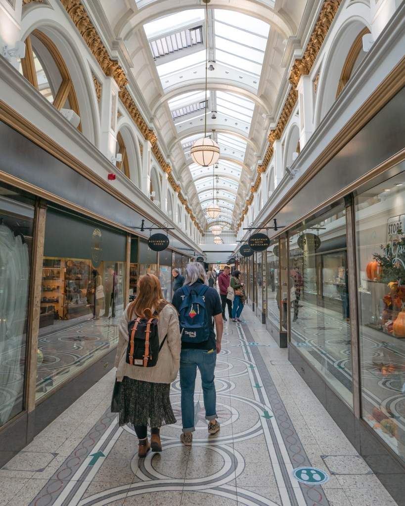 A guide from Taste and Tours showing a lady around Belfast on a walking tour Belfast