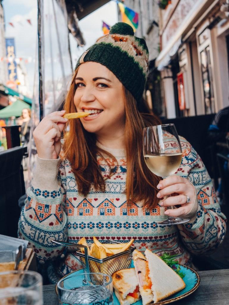 Woman having lunch at Gemelles restaurant on a weekend break in Galway