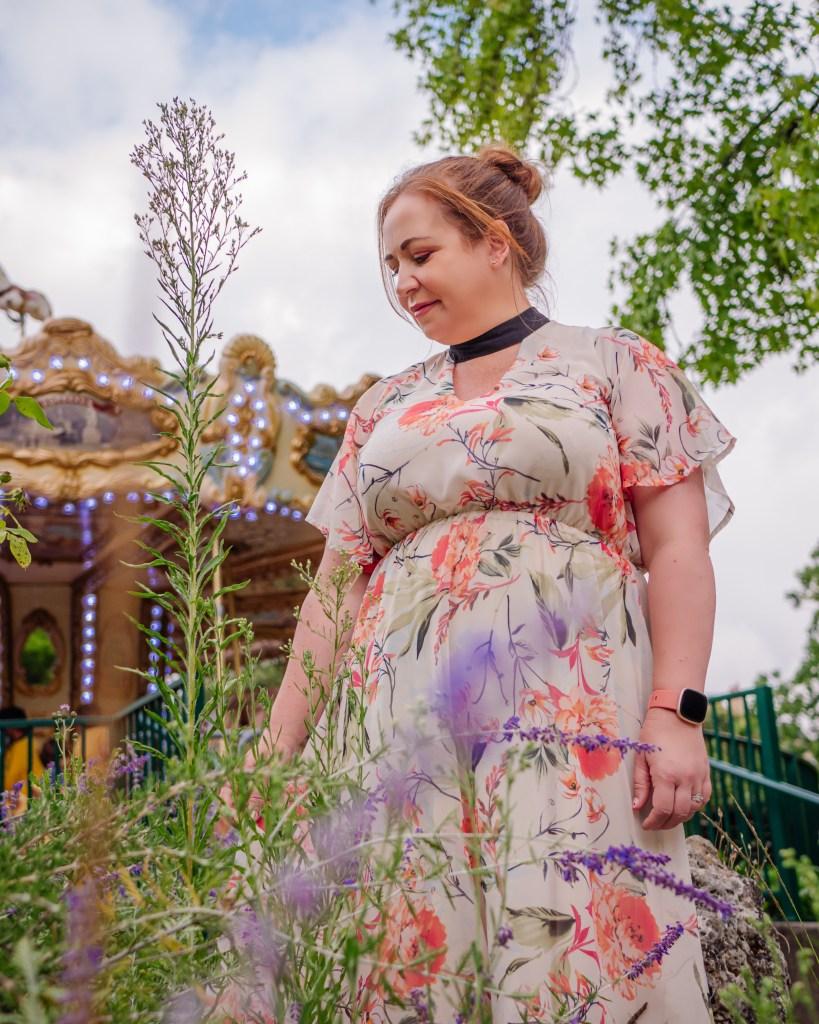 Woman in a floral dress at one of the best instagram spots in Bordeaux, jardin public