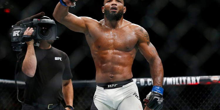 Nov 12, 2016; New York, NY, USA;    Yoel Romero (blue gloves) celebrates after defeating Chris Weidman (red gloves) during UFC 205 at Madison Square Garden. Mandatory Credit: Adam Hunger-USA TODAY Sports