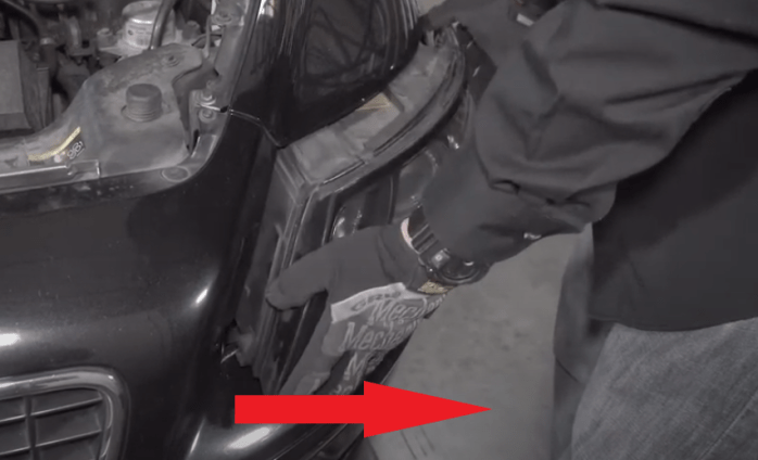 remove headlamp from vehicle housing