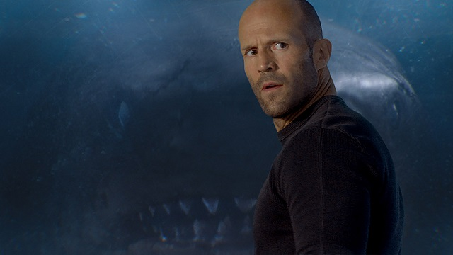You can bet that what The Meg promises on the movie poster is what you're going to get — a bloody big shark. With the latest creature feature set to scare the bejesus out of anyone considering a wade into the ocean, here's what you need to know before you buy your ticket. Pitched somewhere between Jaws and Sharknado, if there's one thing you need to know, it's that you're definitely going to need a bigger boat.
