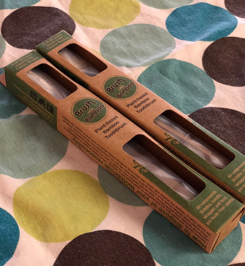 Two bamboo toothbrushes, alternatives to plastic.