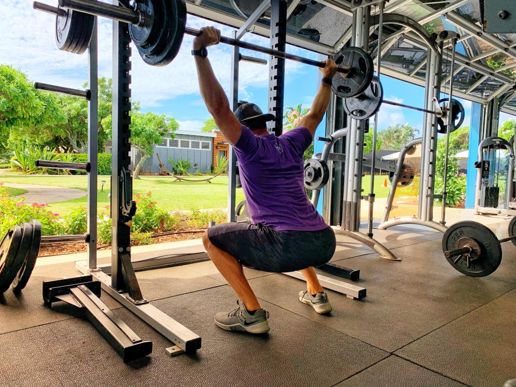 Joe doing overhead squats in Kauai with open air gym