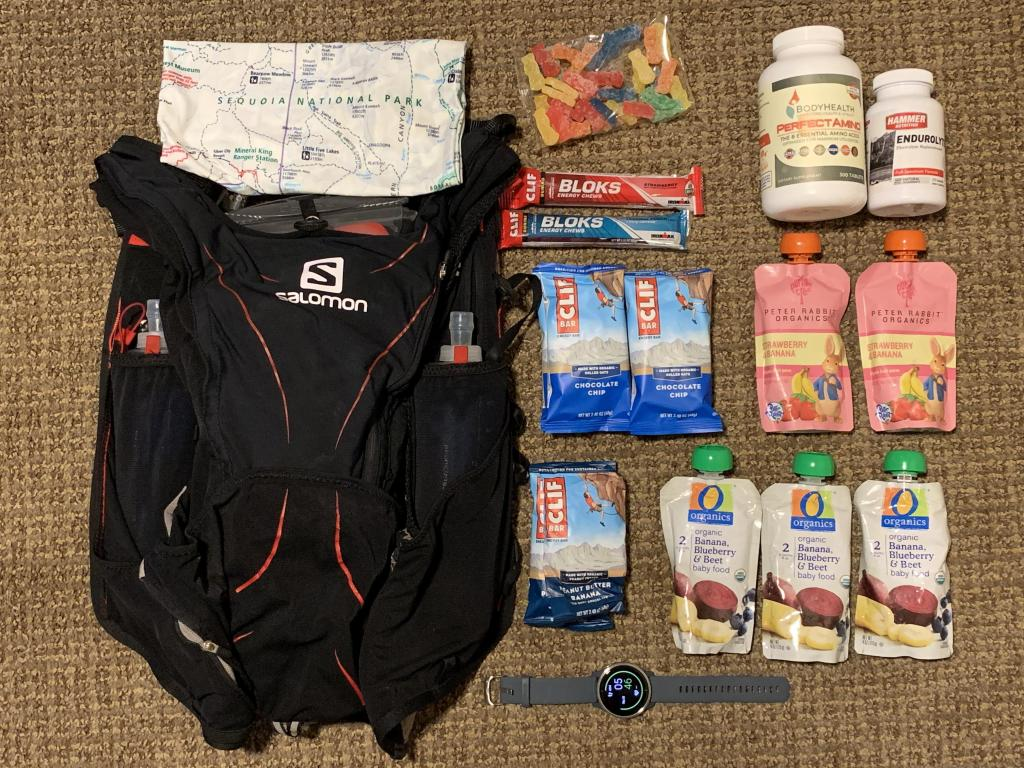Packing for Napali Coast Trail run, including Salomon pack, Clifbar and baby food
