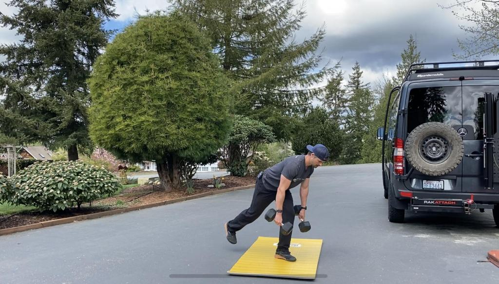 Joe weightlifting doing single leg deadlifts outside