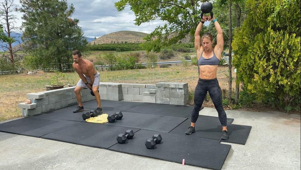 Joe Bauer and Emily Kramer doing kettlebell swings outside in Chelan