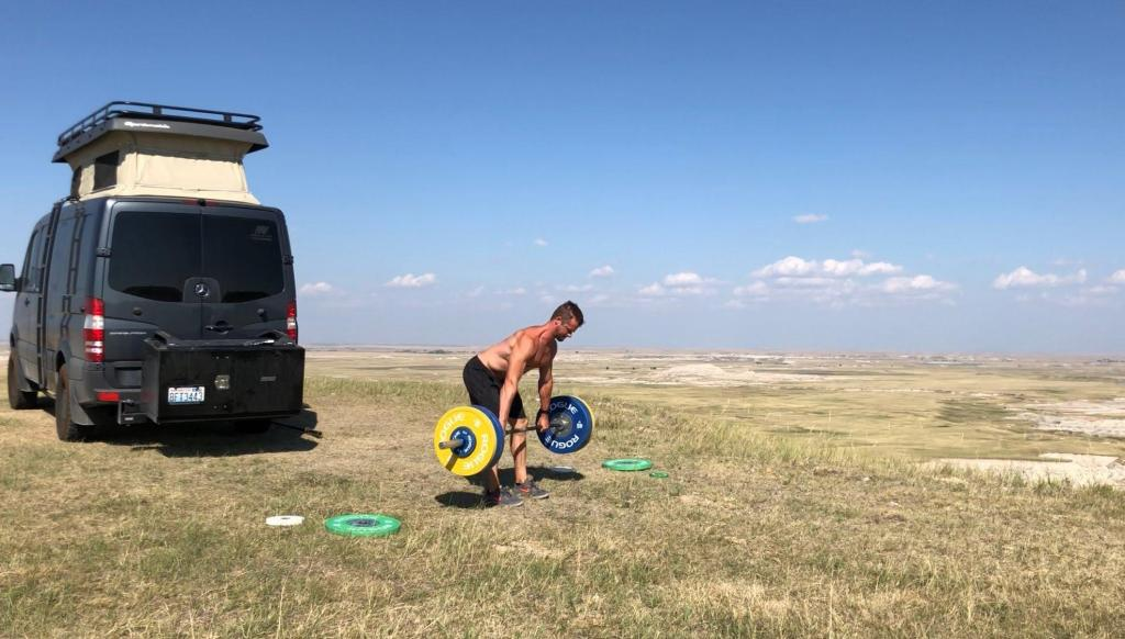 Joe lifting a Rogue barbell outside of the Badlands