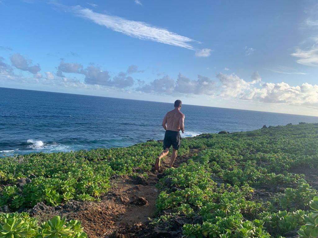 Joe Bauer beach running in Kauai on the coast