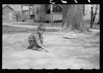 boy_playing_marbles