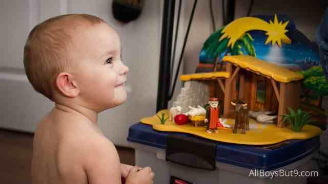 Sarah happy playing baby Jesus