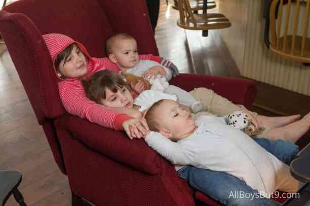 4 little girls sitting on a wingback chair