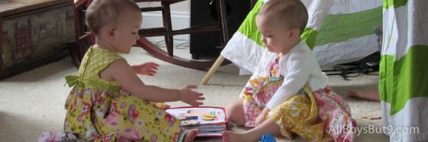 twin girls share quiet book during General Conference