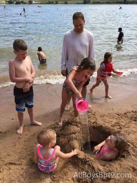cousins playing in the sand