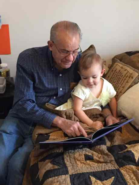 Grandpa reading to Adelynn