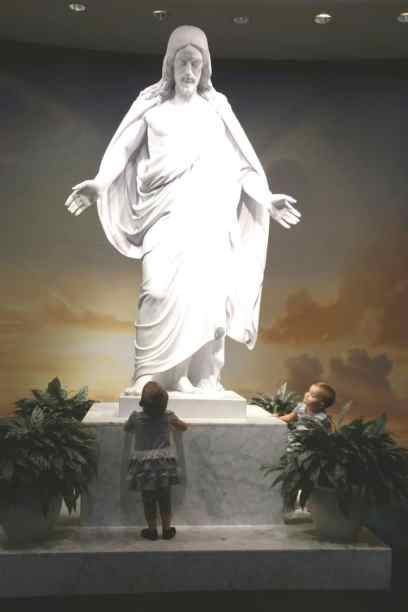 Addie and Sarah are captivated by the Christus statue in Washington DC temple visitor's center