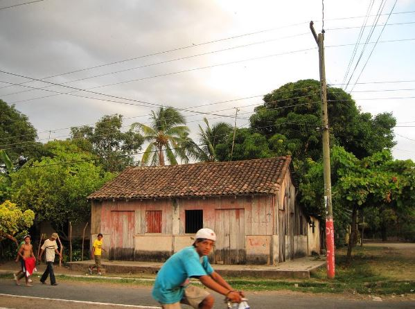 A boy rides a bicycle through town in Granada, Nicaragua