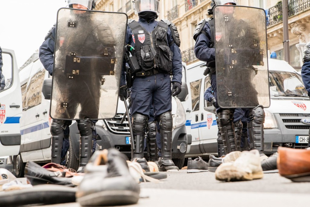 The peaceful protest took a turn as hundreds of police in riot gear surrounded a group of more confrontational, anti-capitalist protesters in the Place de la République. Police fired tear gas canisters into the crowd. Reports have differed about what sparked the change. Photo: Duc Truong via Flickr