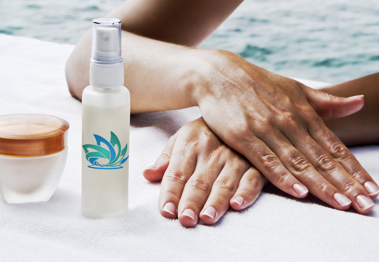 Image of a woman's hands crossed by the pool with skincare products