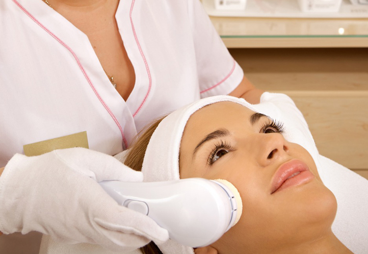 Image of a woman getting a laser facial treatment