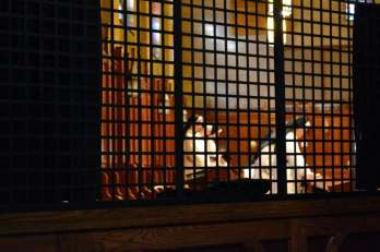 Dominican nuns at prayer in the cloistered side of the chapel