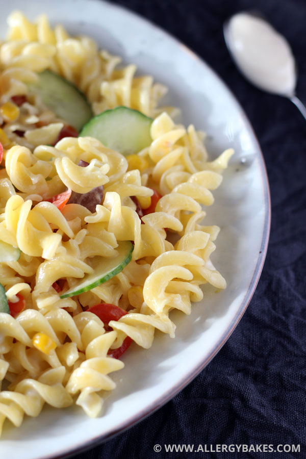 Gluten-free pasta salad with cucumber, grapes, tomatoes and sweetcorn.