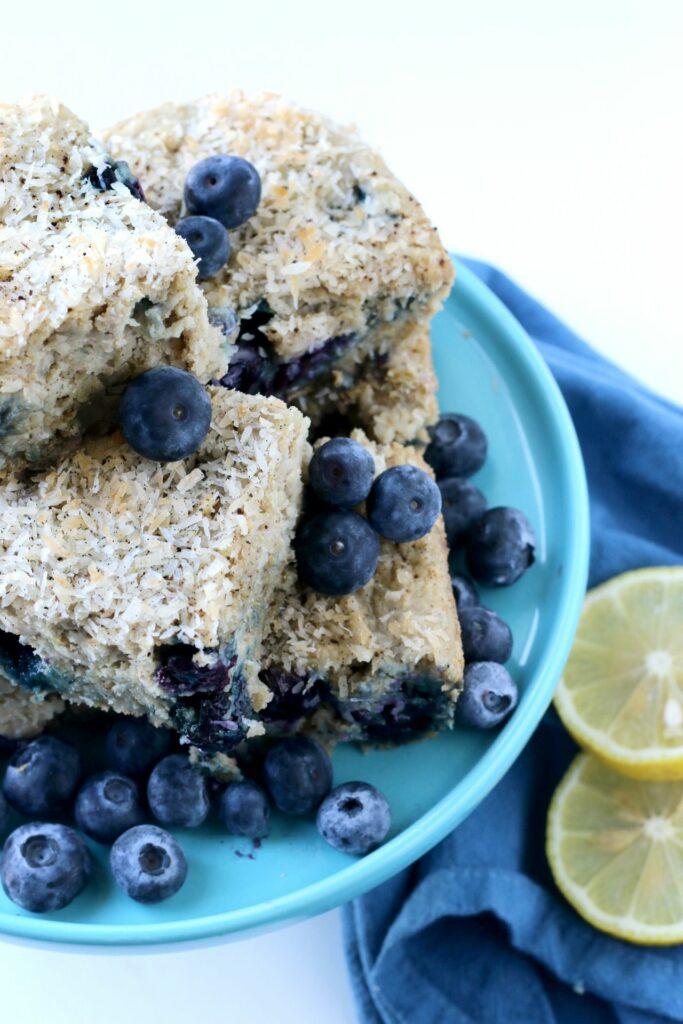 Each delightful bite of this Blueberry Lemon Snack Cake is bursting with fresh berries, lemon & sweet coconut.