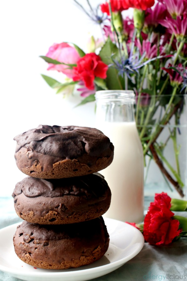 Chocolate donuts stack with milk and flowers