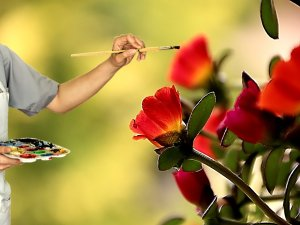 Artist painting red flowers