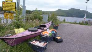 kayak with crates with stuff ready to be packed