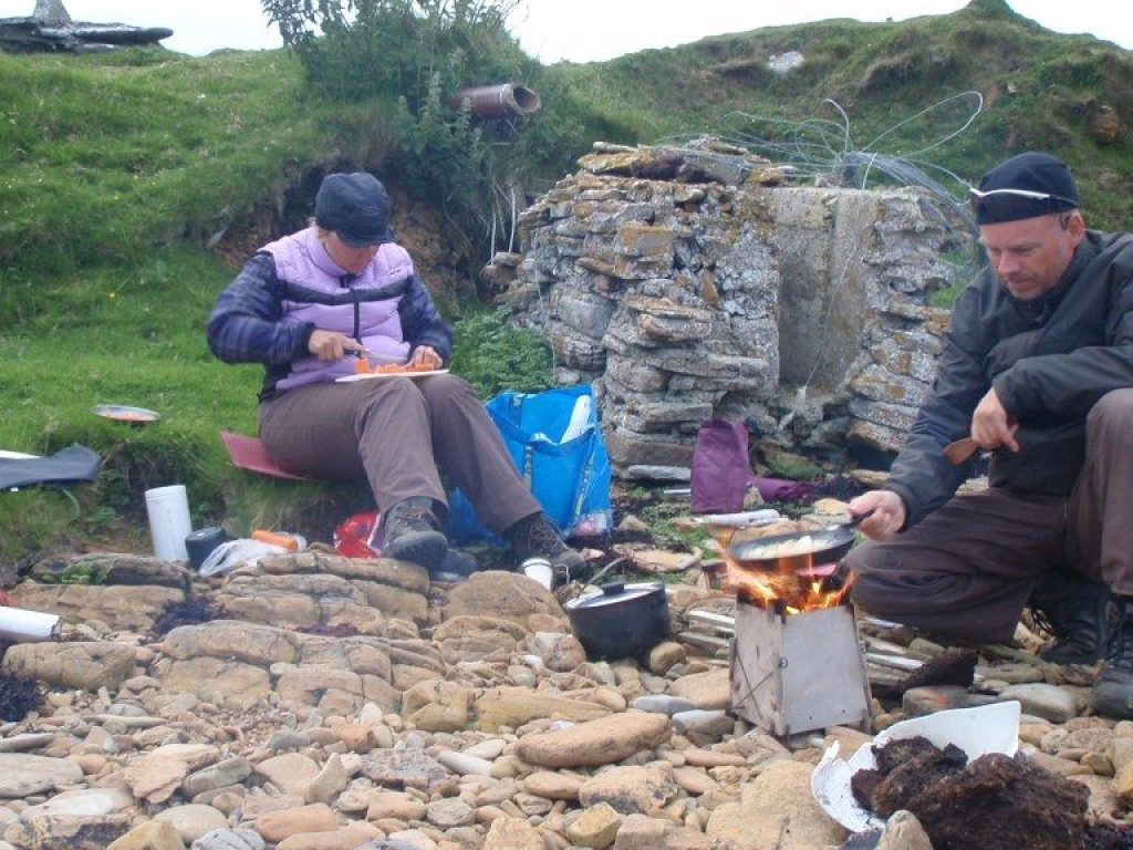 Charlotte and Alexander Gannet are cooking outdoor