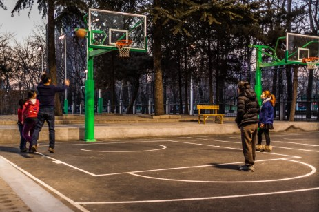 Day Twelve: Today's picture is from the streets of Beijing. Basketball is the most popular sport here in China and temperatures in the low 30's didn't stop this group from playing (all but one of the 12 courts in this park had games playing). — with Melinda Hoyt in Beijing, China.