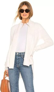 A woman wearing a white open front cardigan from REVOLVE.