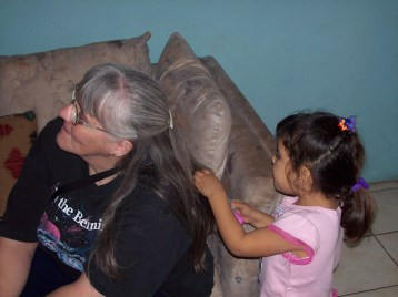 Little girl playing with Kathy's hair