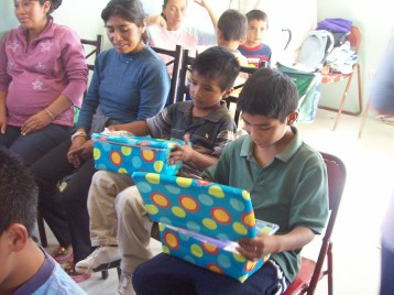 Two boys check out their boxes