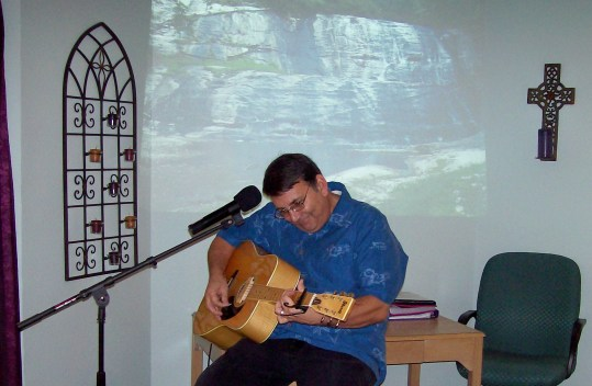 Pastor Dick playing his guitar before our 2nd seminar in Albuquerque