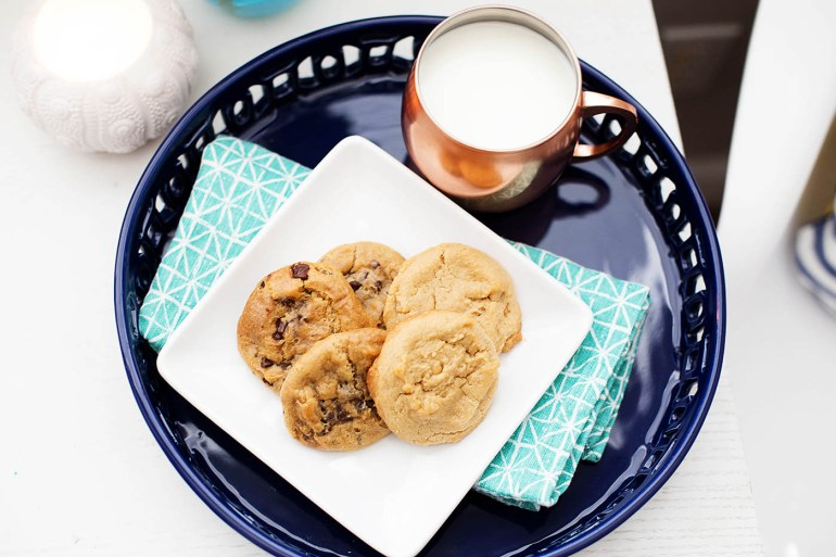 Take an extra 5 minutes to impress your guests. Bake some cookies, cut up some fruit and move accessories around a bit to create a comfy, seasonal spot for socializing!