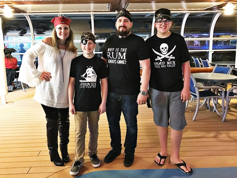 Family wearing pirate themed clothing on a Disney Cruise