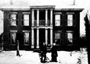 Sarah and Jonathan Ridgeway Haines standing by the Haines House