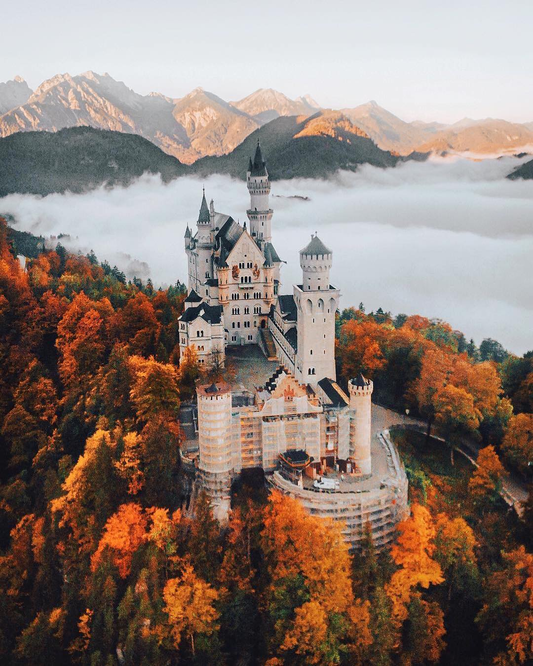 neuschwanstein castle in germany with fall colors