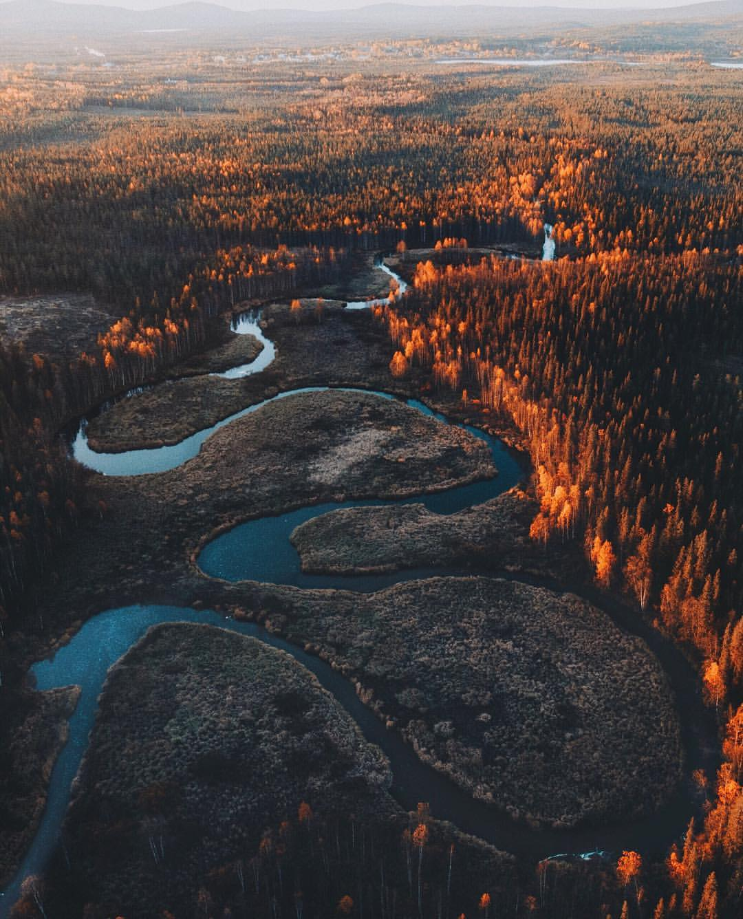 winding river with fall colors in lapland finland