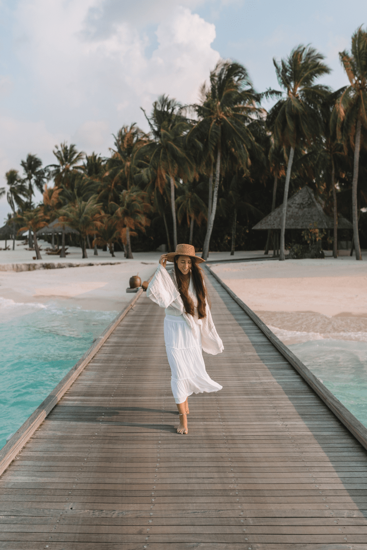 Girl walking on pathway in the Maldives