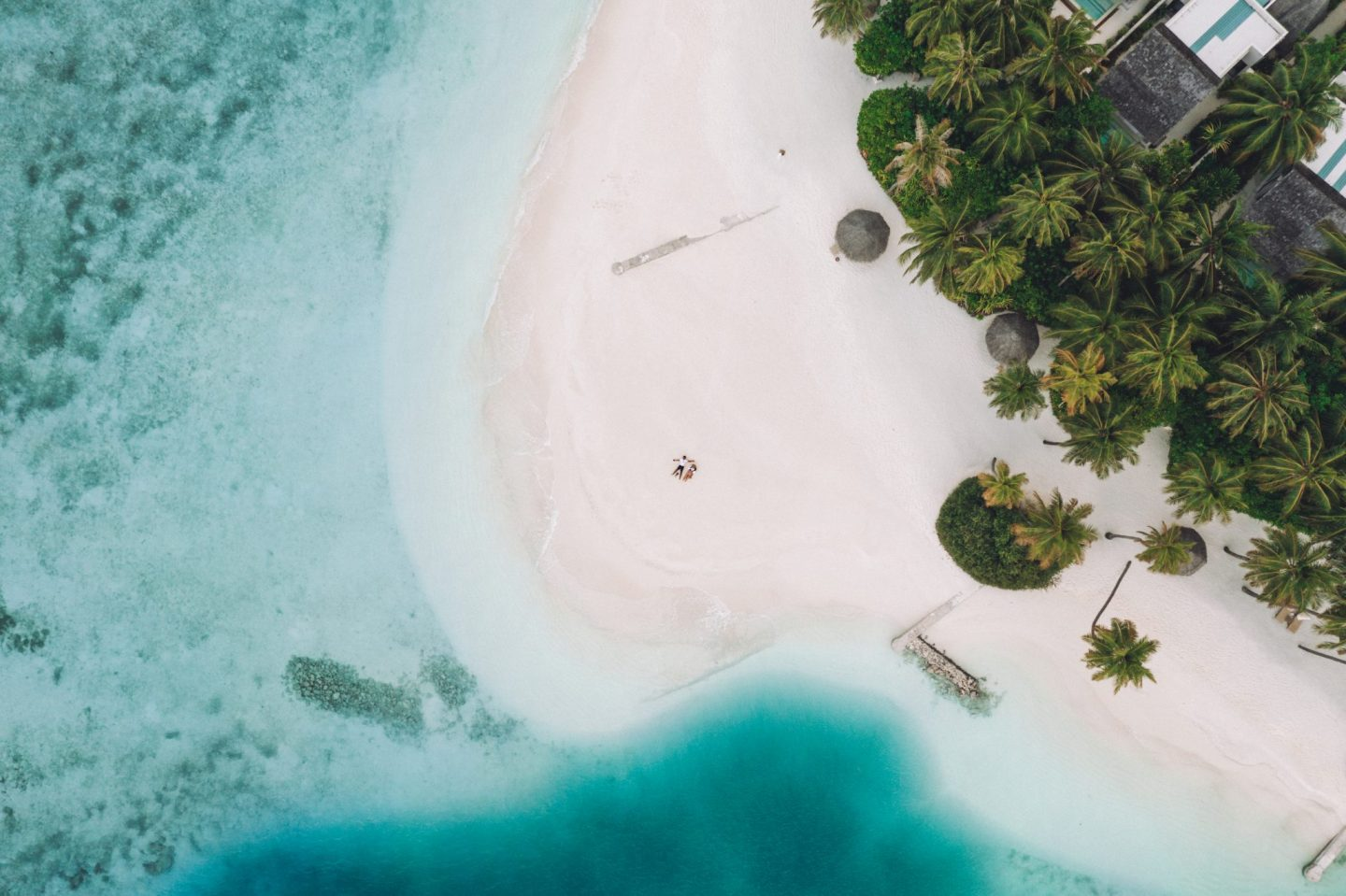 Drone shot of a beach and the ocean in the Maldives